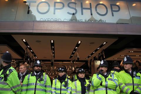 http://www.ameliasmagazine.com/wp-content/uploads/2010/12/UKuncut-Topshop-police-amelia-gregory.jpg