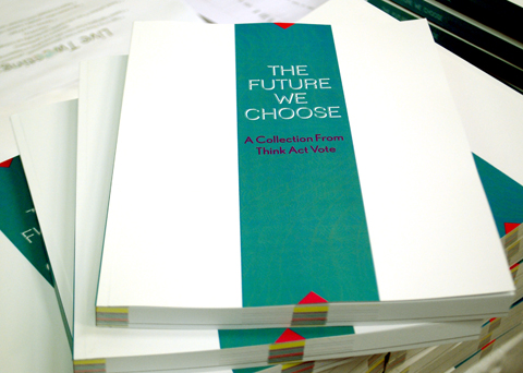 Think Act Vote The Future We Choose Book Launch stack of books