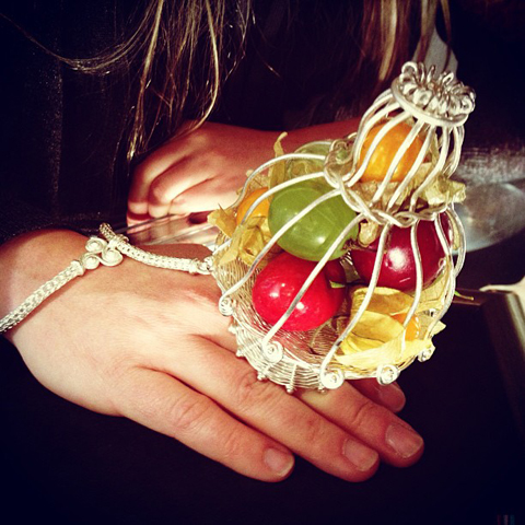 An outsized showpiece ring containing fruit Atelier Laibach