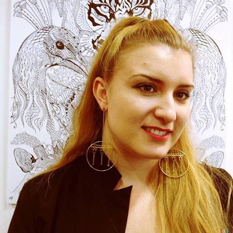 Annie Lucilla wearing her etched earrings