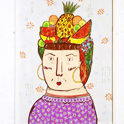 Lydia Hannah Thomas - lady wearing fruit on her head