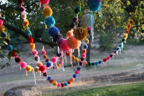 pompom garland in the trees