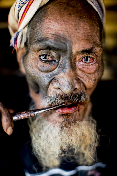 Sumba-Pasola-man chewing betel by James Morgan