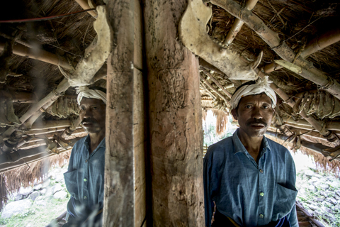 Sumba-Pasola-man in hut by James Morgan